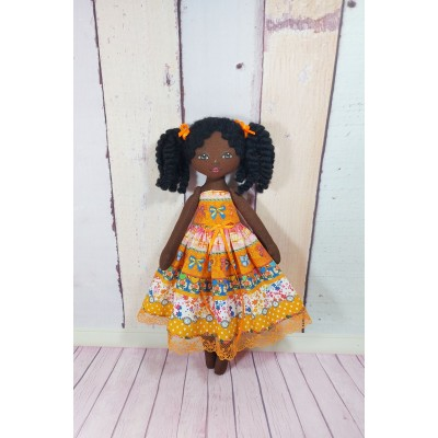 Little Black Doll In Different Dresses