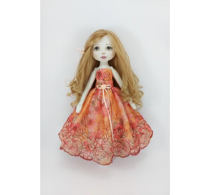 Little Rag Doll In A Orange Dress